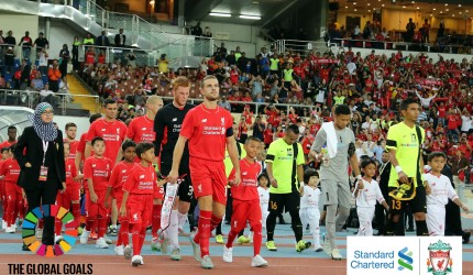 Mekfah, from the inner city slums of Bangkok gets to be Jordan Henderson's mascot in a Liverpool FC game.